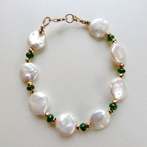White Pearl & Gemstone Bracelet AAA Chrome by TransfigurationsJlry, $98.00  Genuine 10mm white coin pearls are mixed with beautiful deep emerald green AAA faceted chrome diopside gemstones and faceted gold pyrite nuggets in this striking handmade bracelet. The pearls have good smoothness and excellent luster; all three types of gemstones catch and reflect the light in different and complementary ways for a lot of shine.   The bracelet measures 7 3/4 inches