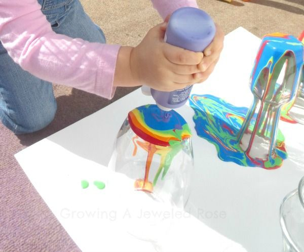 Rainbow Pour Painting Vases // Dollar Store vases & acrylic paint; also has links to using the technique on terra cotta planters, birdhouses, & eggs