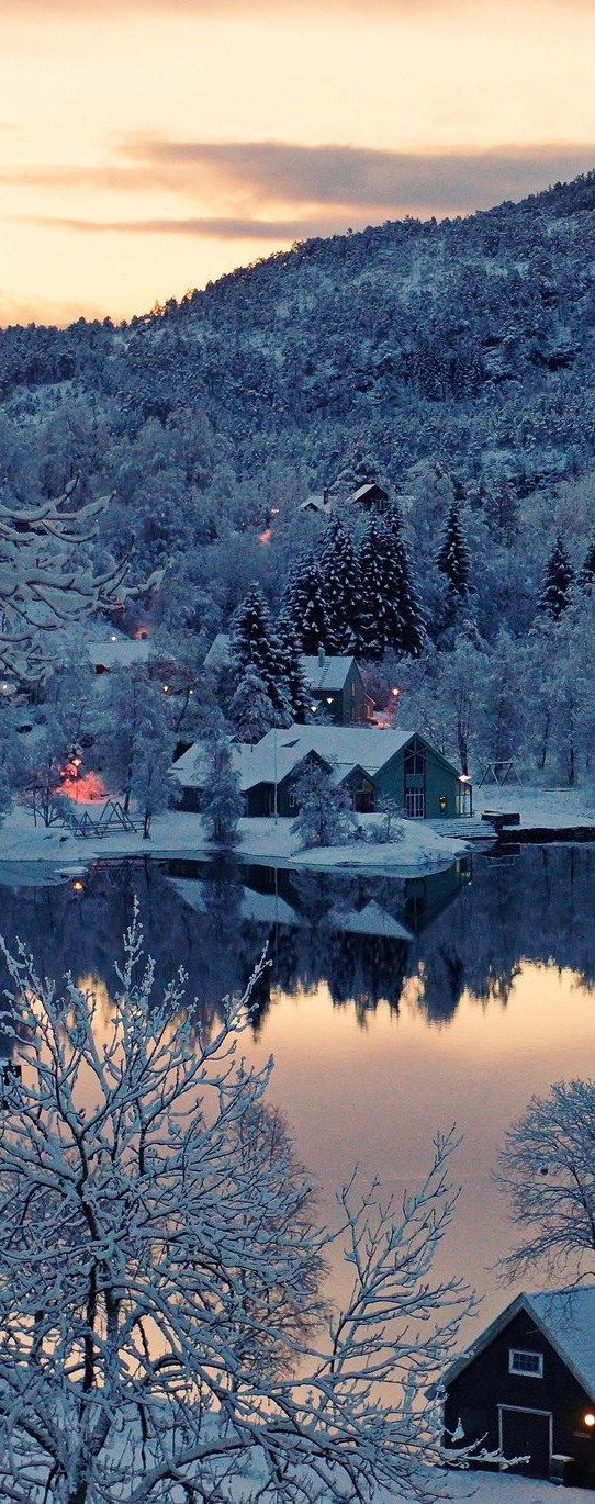 I'd like to be here at this winter cottage on a lake in the mountains.