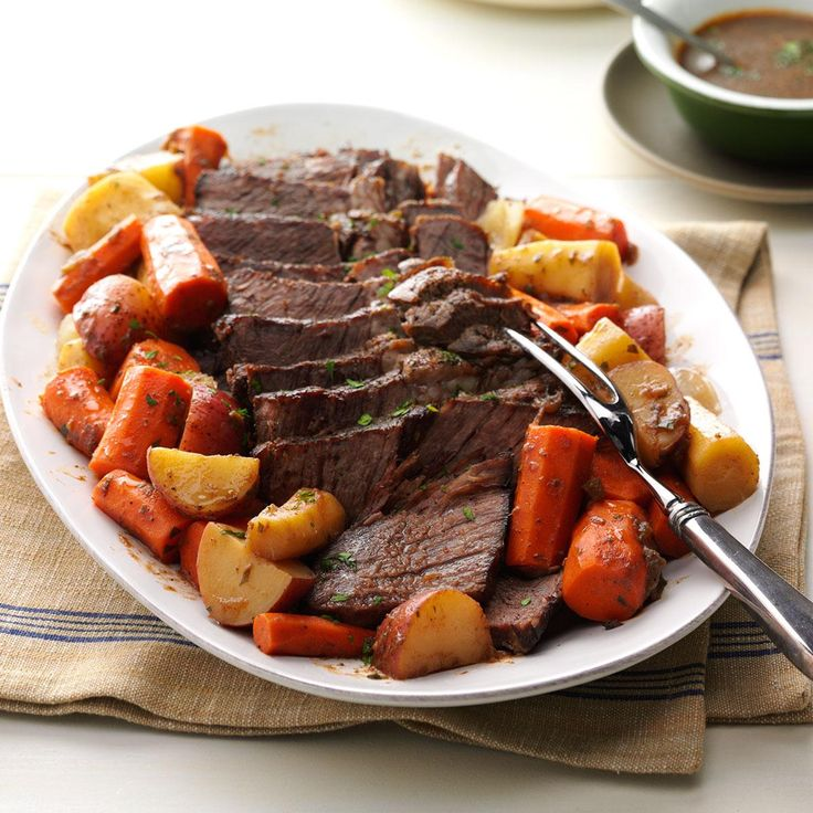 "Ultimate Pot Roast Recipe -When juicy pot roast simmers in garlic, onions and veggies, everyone comes running to ask, ""When can we eat?"" The answer? Just wait—it will be worth it. —Taste of Home Test Kitchen"