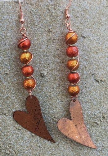 ARTISAN FLAME PATINA HEART EARRINGS with orange and golden accented textured beads.  The hearts hang gracefully from wire wrapped copper wire. The textured beads beads are wire wrapped and join the co