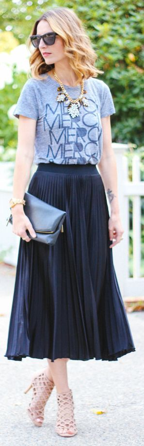 Pleated midi skirt, grey graphic tee, statement necklace, sandals, finished with leather biker jacket