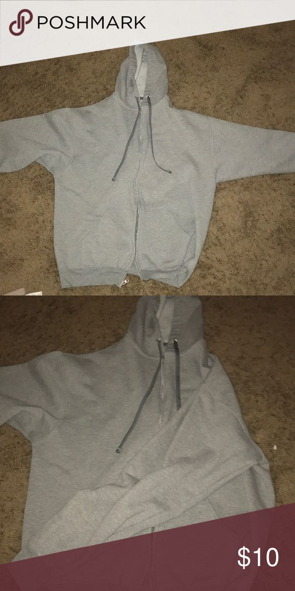 Grey zip up hoodie Grey zip up fruit of loom hoodie is very comfortable and cozy, this is sized XL in women's but fits around a medium or large sized person. Gently worn and in great condition Fruit of the Loom Tops Sweatshirts & Hoodies