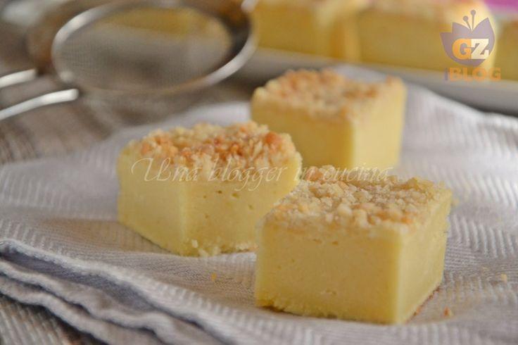 Torta ricotta e mandorle, un dolce fresco e umido da servire a cubotti, ottimo in ogni momento della giornata.