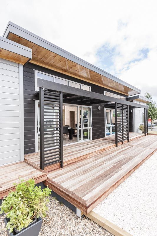 Show home with split level roof line.  Lockwood small home with 3 bedrooms and 2 bathrooms.  In Takanini, Auckland.  Fresh green and turquoise interior
