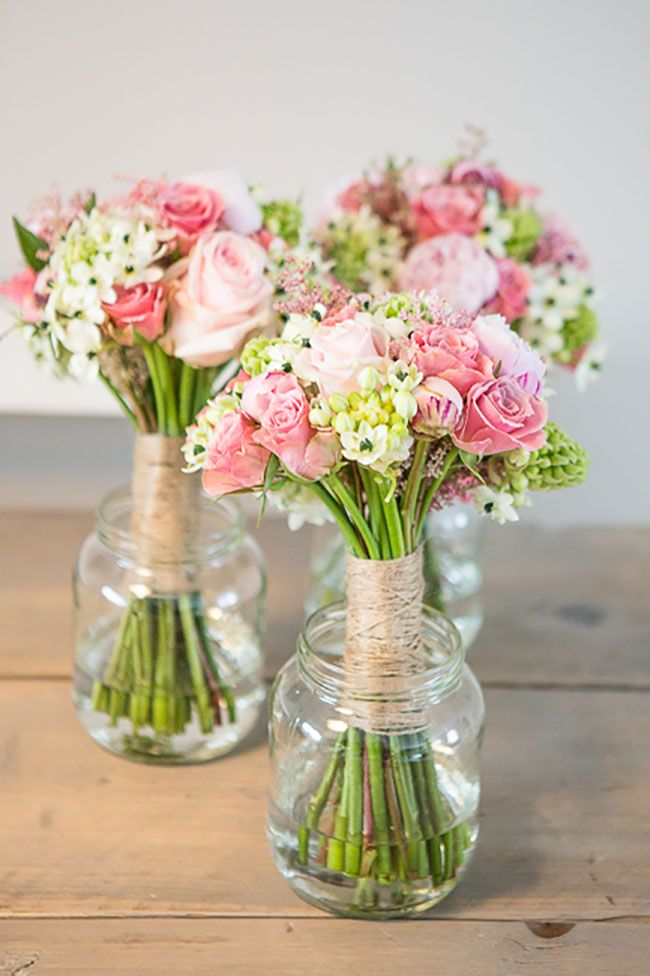 Several bouquets of flowers in a glass pot