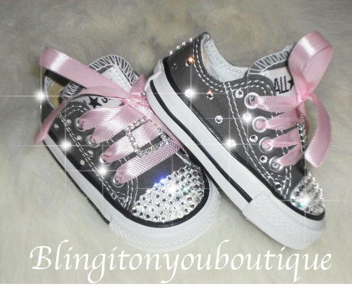 We are starting to custom adult sizes as well! All shoes are original Converse brand and are made with beautiful Authentic Swarovski crystals! Show Stoppers!!! :) These Beautiful shoes have bling all around the shoes!! Infant size shipped in original box- Charcoal Gray Lots of Swarovski Crystals HAND placed. please note the sliders are not Swarovski All Toddler sizes are available 2 week turn around time Sparkle and Shine Bright like a Diamond! :) Great for pageants! Great for Photo ...