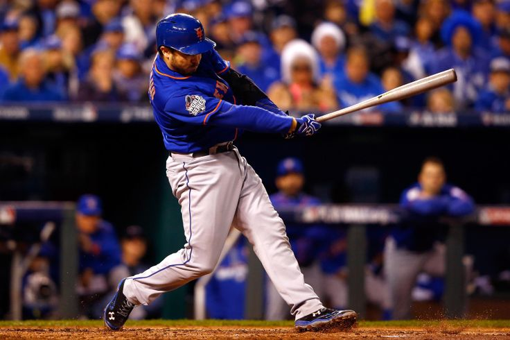 Travis d'Arnaud of the New York Mets hits an RBI single in the fourth inning against the Kansas City Royals during Game 1 of the World Series at Kauffman Stadium on Oct. 27, 2015. (Photo by Jamie Squire/Getty Images)