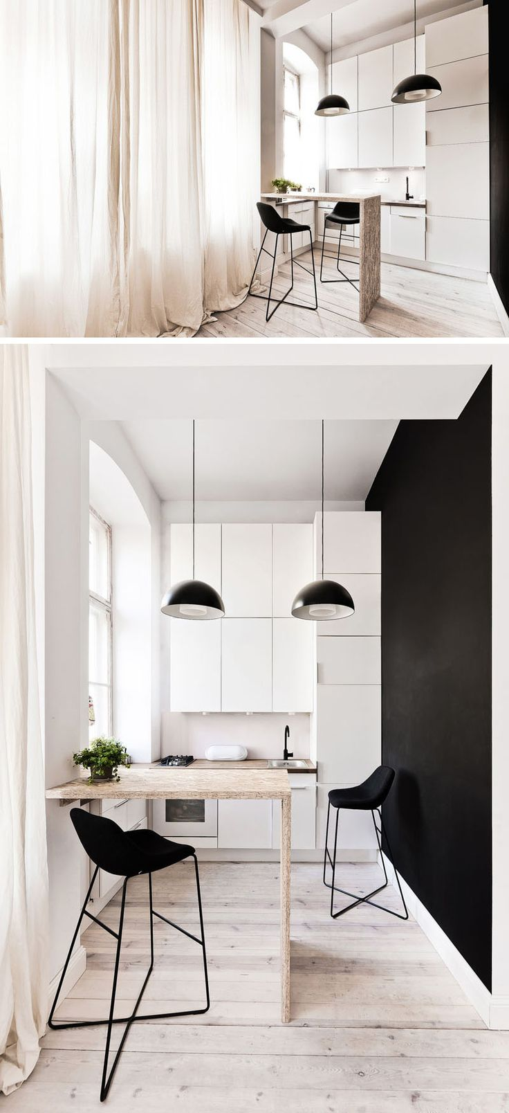 This tiny kitchen is small but functional. As the space it quite tall, there's an additional row of upper cabinets to increase the storage space. A small breakfast bar provides a place to eat, and acts as a separation between the kitchen and living area.