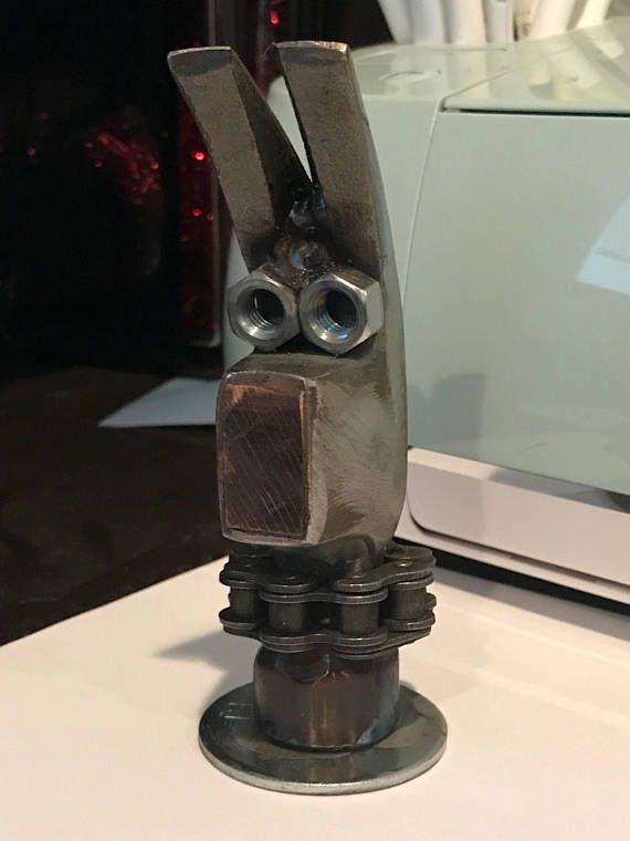 This is a hand welded paper weight in the shape of a dog. I made this from an old hammer head and other scrap materials. This is a perfect gift for yourself or someone you know who is a dog lover. Weighs about 1 lbs. 6oz. Sprayed with a clear coat to protect the finish.