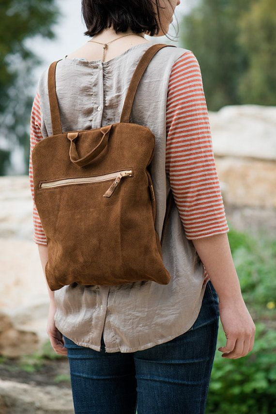 Boro bag is a womans backpack made of soft suede leather This bag is one of a kind Handles Zipper closure  Inside zipper pocket    Very comfortable