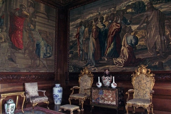 The State Drawing Room. The famous Mortlake Tapestries depict the Life of Christ, taken from drawings by Raphael. Like most rooms, this one is kept dark to protect the tapestries. The oriental porcelain is 17th century, imported from China which was the only source of porcelain at the time.