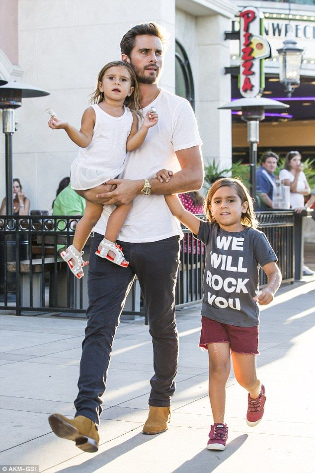 Precious cargo: The 32-year-old reality star carried Penelope in his arms as he held hands with Mason, appearing content and energetic