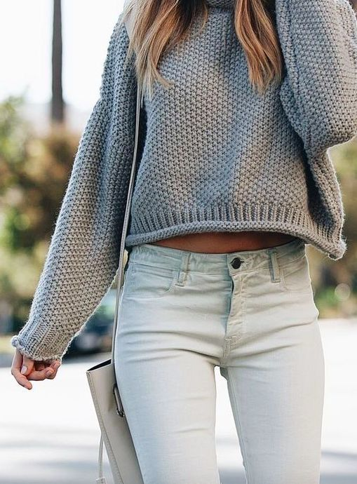 Gray knit sweater with white denim jeans.