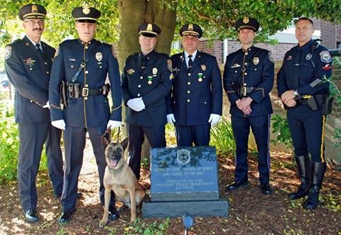 The Westport Police Department today dedicated a memorial honoring the Police Service Dogs that have served the department. The dedication at police headquarters followed the annual Memorial Day service, held prior to the parade. The memorial was funded through donations by Poster Animal Hospital, Westport Police Union Local 2080, and the Westport Police Benevolent Association.