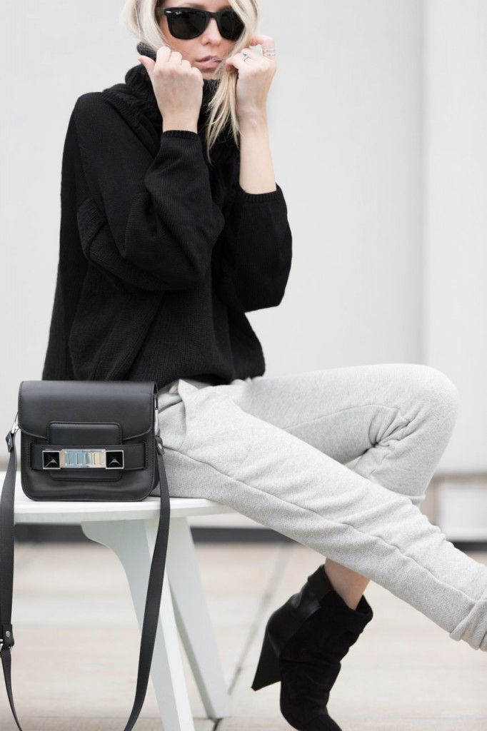 Figtny is wearing a grey joggers from Alternative Apparel, black turtleneck from Helmut Lang, black ankle boots from Isabel Marant and a bag from Proenza Schouler