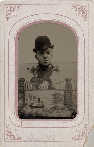 """""""This tintype of a man wearing a derby walking across a bridge is dated Dec. 1888. The top edge of the card can be clearly seen under his chin."""""""