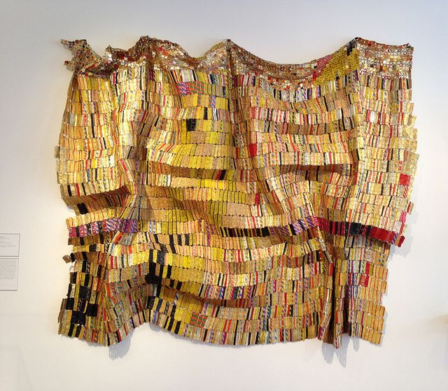 El Anatsui, Taago at High Museum Atlanta - made from metal scrap such as the discarded tops and necks of liquor bottles --- A Metal Cloth Of Art ---