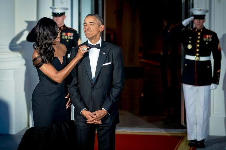 Michelle Obama adjusts President Obama's bow-tie prior to greeting Xi Jinping, China's president, and Peng Liyuan, China's first lady, both not pictured, on the North Portico of the White House, Sept. 25, 2015. (Photo by Pete Marovich/Bloomberg/Getty)