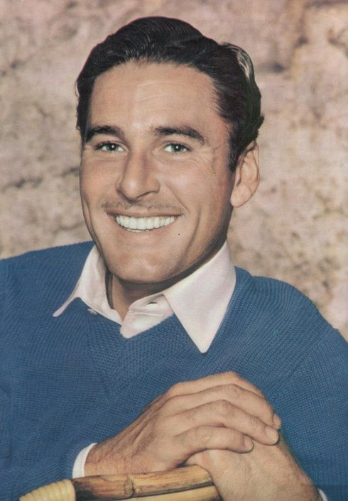 Errol Flynn, what a beautiful smile, so handsome!  My vote for Magneto if X-Men was made in the 1940s.