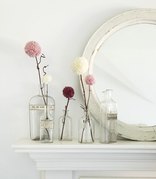 pom pom flowers how divine! Love the rustic mirror too