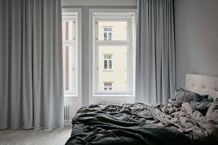 bedroom in a lovely apartment in grey shades at fantastic frank via http://www.scandinavianlovesong.com/