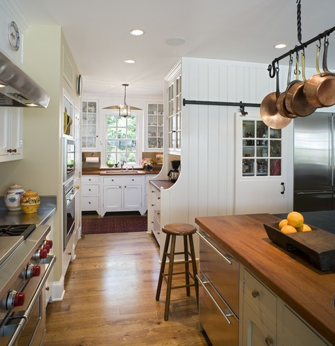 LOVE the pantry door on sliders, stainless counter next to stove w/wood/stone island. Cabinetry is also nice, like the mix of glass front w/closed.  Canary Cottage - Kitchen - traditional - kitchen - philadelphia - Archer & Buchanan Architecture, Ltd.