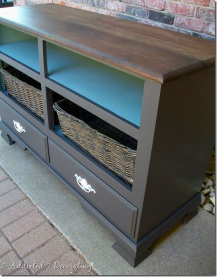 transformed dresser - this would be a great gift wrapping station, with the rolls of wrap on the blue shelf, bows and embelishments in the baskets and the drawers segmented for tapes, scissors, etc.