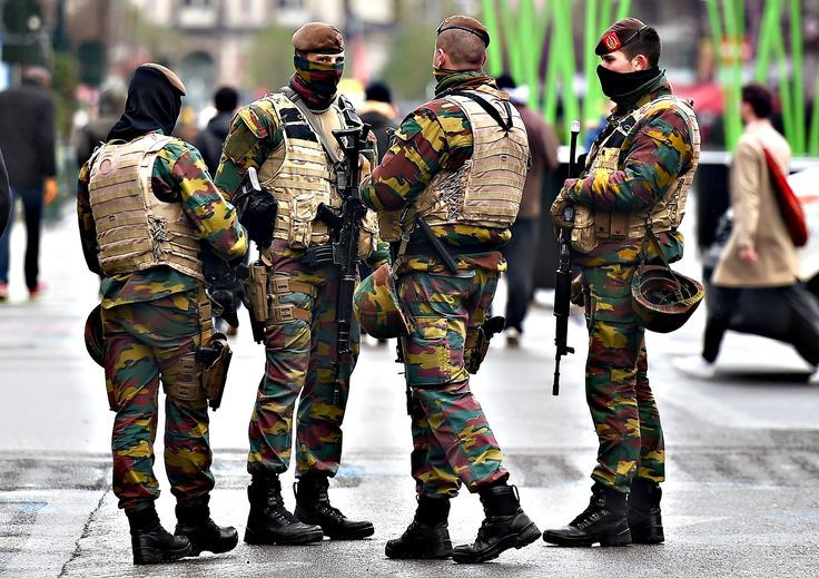 Soldiers patrol in the streets, in Brussels, on Tuesday as the Belgian capital remains on the highest possible alert level. Brussels began a fourth consecutive day in lockdown under a maximum terror alert after Belgian police staged a series of raids but failed to find a key Paris attacks suspect