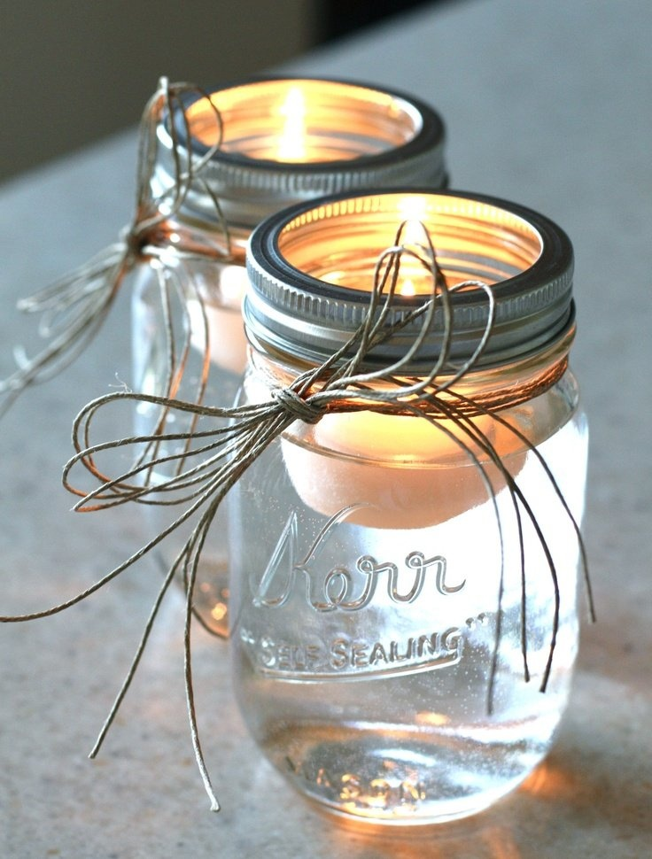Mason jars and floating candle. For high top inside and out door tables