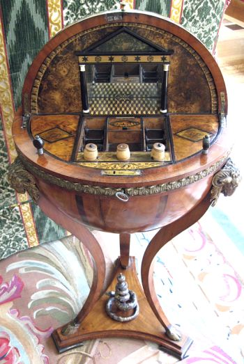 Work table with sewing tools inside globe. Biedermeier style. Neoclassical, with fine veneer, usually made in Vienna or Berlin in the early to mid 1800's.