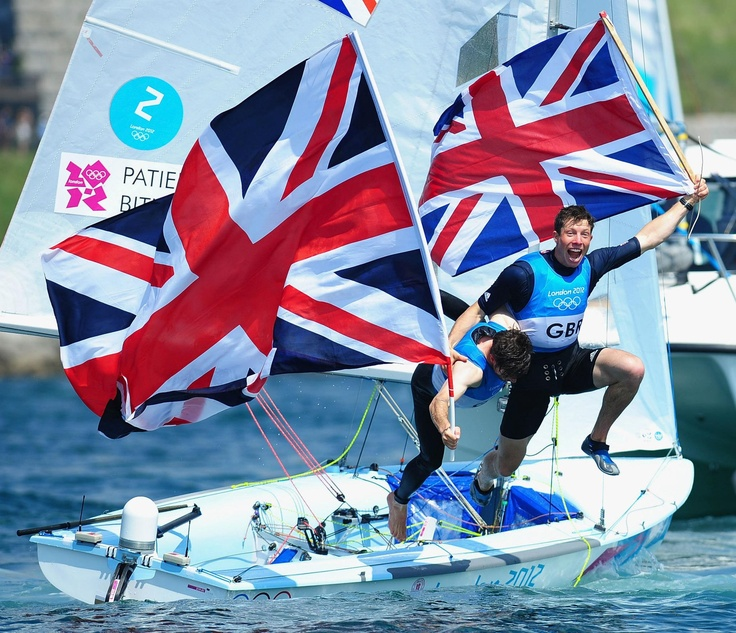 Day fourteen: Luke Patience and Stuart Bithell of Team GB celebrate finishing second and winning the silver medal in the Men's 470 Sailing.