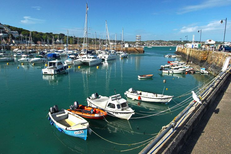 Boats shelter inside St. Aubin Harbor on the Isle of Jersey, one of the British Channel Islands, located just 14 miles off the French coast