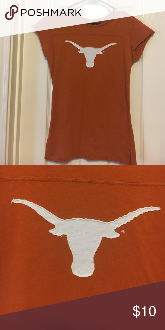 Texas Longhorn T-Shirt It is a medium, but fits tight like a small! Only worn once.  🚫NO TRADES🚫 Always make a reasonable offer, most likely will accept or negotiate!  SAME/NEXT DAY SHIPPING!  (I do not ship on the weekends) Feel free to ask questions in the comment box! Tops Tees - Short Sleeve