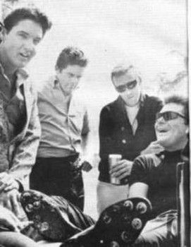 Elvis with (seated) Max Baer, Jr. aka Jethro Bodine of TV's Beverly Hillbillies, often played in Elvis' football games in Bel Air in the early 1960s. (Jack Dennis collection, from Harold Lloyd (cousin of Elvis Presley) cq http://www.examiner.com/slideshow/ten-things-you-didn-t-know-about-donna-douglas-and-elvis-presley#slide=10