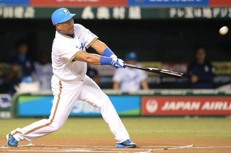 Seibu Lions legend Kazuhiro Kiyohara hits a single to right-center field off Orix Blue Wave legend Kouji Noda during the ceremonial first matchup before a NPB baseball game between the Saitama Seibu Lions and the Orix Buffaloes at Seibu Dome on August 30, 2013 in Tokorozawa, Saitama.