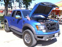 """Ford Raptor Trucks -For the 2010 model year, Ford introduced the SVT Raptor model of the F-150. Intended for dedicated off-road use, the Raptor has a number of modifications to improve its off-road ability. It includes a full set of FOX shocks with 11.2"""" of front suspension travel and 12.1"""" of rear travel."""