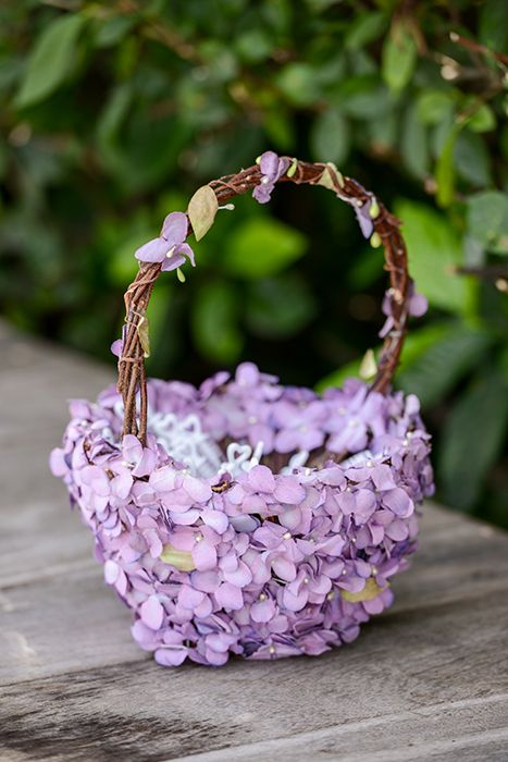 Rustic inspired flower girl basket with purple flowers at a Disneyland wedding                                                                                                                                                     More