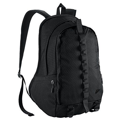 Nike Karst Command Backpack, Black. Front lash tabs and bottom cargo carry straps for easy access to essentials. Contoured, cushioned back panel and straps offer comfortable carrying. Pockets lined with jersey knit material to help protect small items and devices. Woven, water-resistant fabric helps keep gear protected in challenging conditions. Dual-zip main compartment for secure, spacious storage.