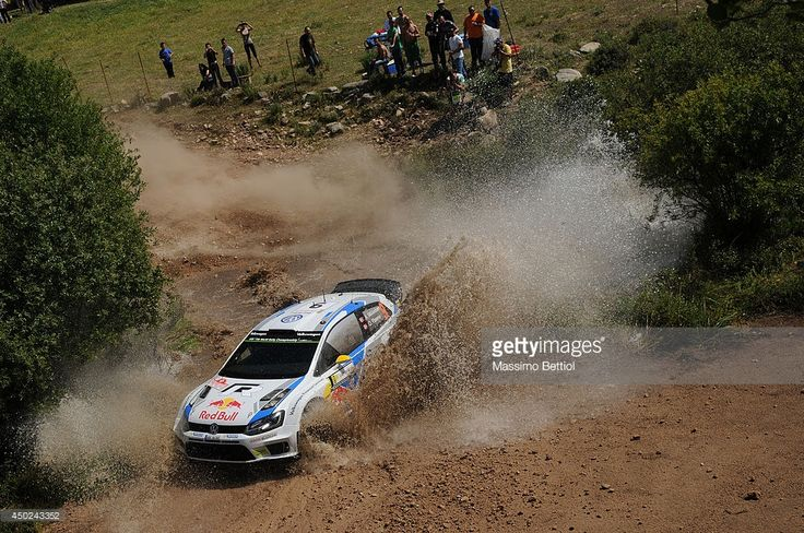 Andreas Mikkelsen of Norway and Ola Floene of Norway compete in their Volkswagen Motorsport II Polo R WRC during Day Two of the WRC Italy on June 7, 2014 in Alghero, Italy.