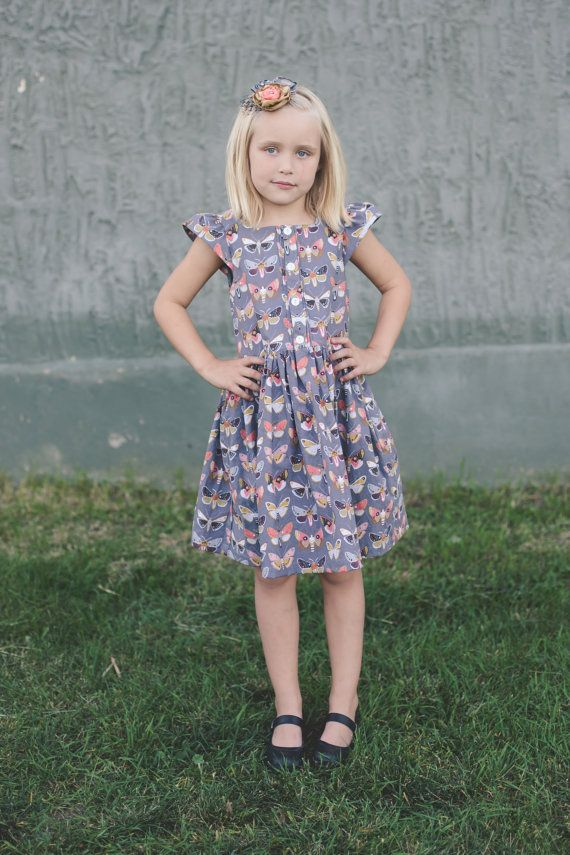 The All Spice dress features a square-neck with 2 different closures for the front: Button or Zipper. Back is completely closed. It also comes with 4 sleeve options: Flutter, Sleeveless, Cap and Long sleeve. This dress is perfect for all seasons and has a size range that stands from baby to tween!  It comes in 11 sizes:  6-12 mos. 12-18 mos. 2T 3T 4T 5 6 7 8 10 12  Skill level: Advanced Beginner - Skills used for this pattern *zipper, *buttons, *pintucks and a lining. (closure is optional…