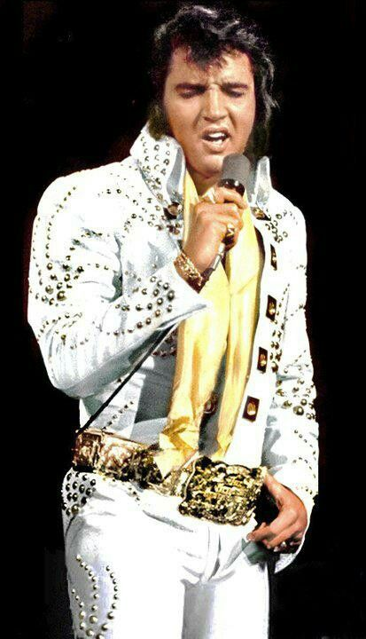 Elvis again with his 'International Belt'. I somehow think he was proud of it, which he should be, and I also think he liked the gold                                                                                                                                                      More