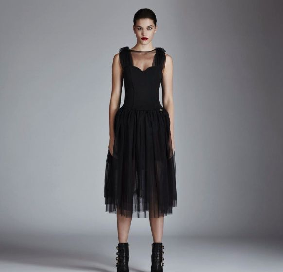 """""""Neva"""" is one of the best expression of the dark fairy mood of the FW16 collection. Tulle dress with tutu effect skirt and volume on the shoulders, available in our stores and online"""