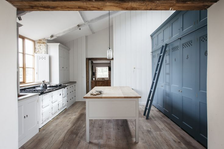 In a traditionally detailed kitchen in Norfolk, Plain English added a wall of cabinets, with the upper cabinets accessed via a library ladder. See more at Kitchen of the Week: The Plain English Power in Numbers Kitchen. Photograph courtesy of Plain English.
