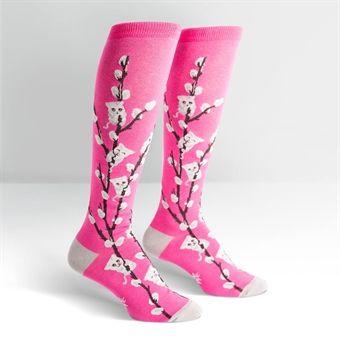 Rosa knästrumpor med vide-kissar