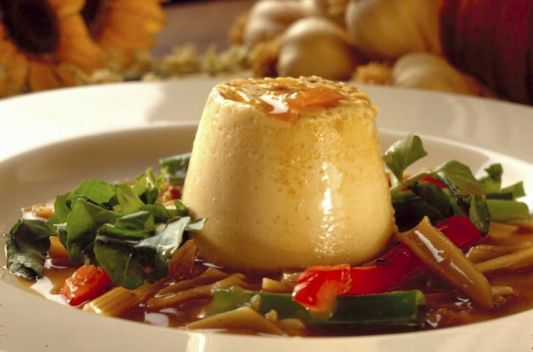 Savory custards flavored with nutty roasted garlic are topped with an unusual sauce of sliced garlic. Read more food recipes with pictures and videos.