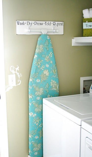 I love this idea to hang the ironing board! The House of Smiths - Home DIY Blog - Interior Decorating Blog - Decorating on a Budget Blog