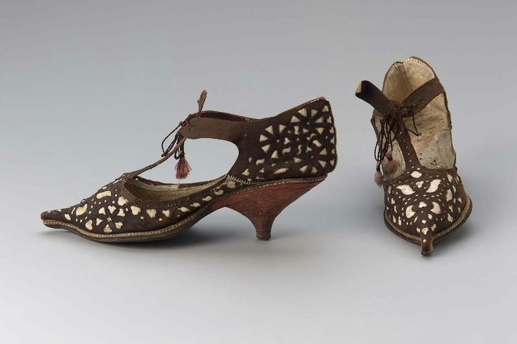 Early 18th century French Women's shoes at the Museum of Fine Arts, Boston - In the early 18th century, many shoes were fastened with ties/laces rather than buckles.