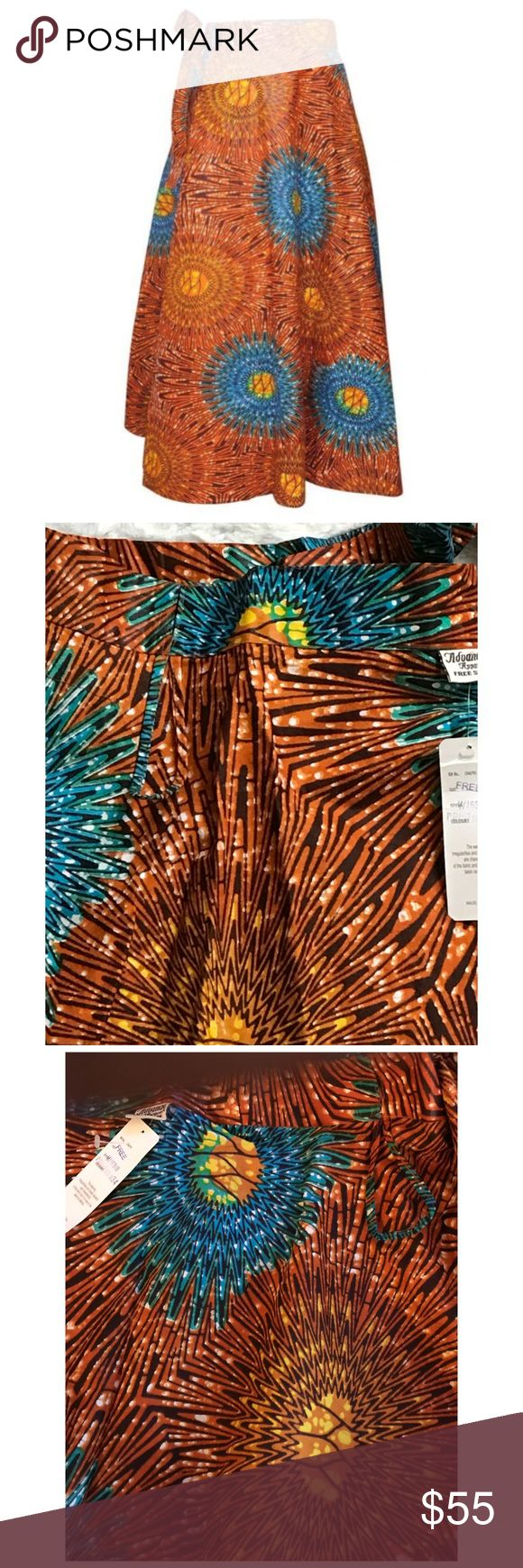 """Ankara *orangeburst* Maxi Wrap Skirt This gorgeous Maxi Wrap Skirt  Features Bold Circles of Orange & turquoise hues 4 Panels made of 100% Cotton Attached waist tie  1 1/2"""" waist band Fits up to 3X  Measures approximately  Up to 42"""" waist 39"""" Length Skirts Maxi"""