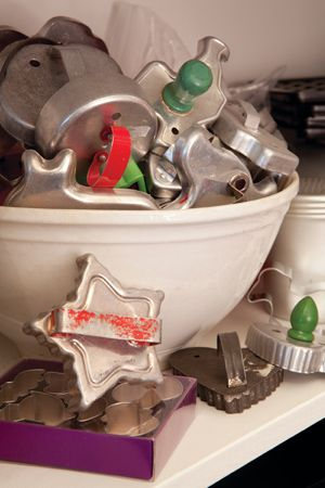 Vintage Cookie Cutters...in an old bowl.  Add a few sprigs of pine greenery...